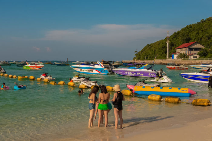 KOH LARN, THAILAND - OCTOBER 23, 2016: A beach This is one of the nice beaches of Koh Larn on a sunny day. Koh Larn is a small island in the Pattaya area and a favorite place of chinese tourists. ASIA Thailand Beach Beauty In Nature Day Enjoyment Horizon Over Water Koh Larn Large Group Of People Leisure Activity Lifestyles Men Nature Outdoors People Real People Sand Scenics Sea Sky Travel Destinations Vacations Water Women
