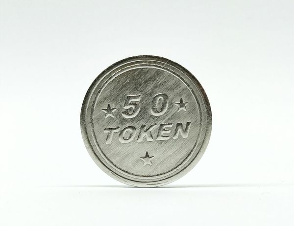 One toys token Token Metal Silver  Rounded Isolated Editorial  Finance Coin Currency Savings Single Object Wealth No People Close-up