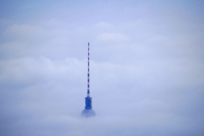 High Section Of Fernsehturm Against Cloudy Sky