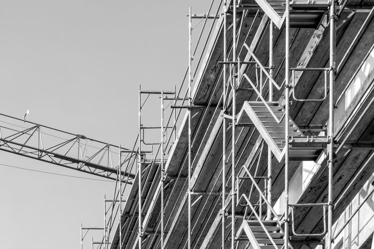 Black & White Construction Construction Site Field Scaffolding Work Architecture Black And White Building Exterior Built Structure Clear Sky Construction Work Day Framework Low Angle View No People Outdoors Site Staging