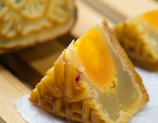 In the Chinese tradition, the Mid-Autumn Festival, people need to eat moon cake. Close-up Day Dessert Focus On Foreground Food Food And Drink Freshness Indoors  Indulgence No People Plate Ready-to-eat Serving Size Sweet Food Table Temptation Unhealthy Eating Yellow