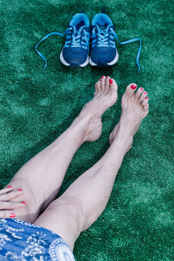 Low section of woman legs on grass