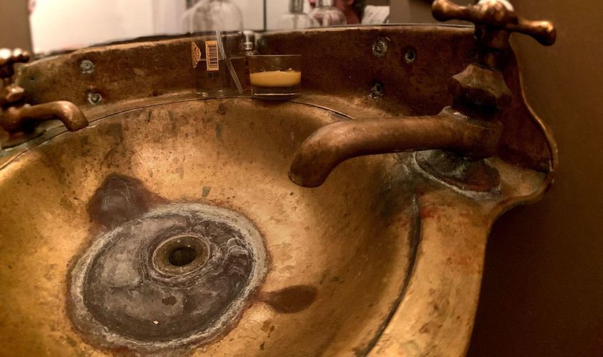 High angle view of old faucet in kitchen