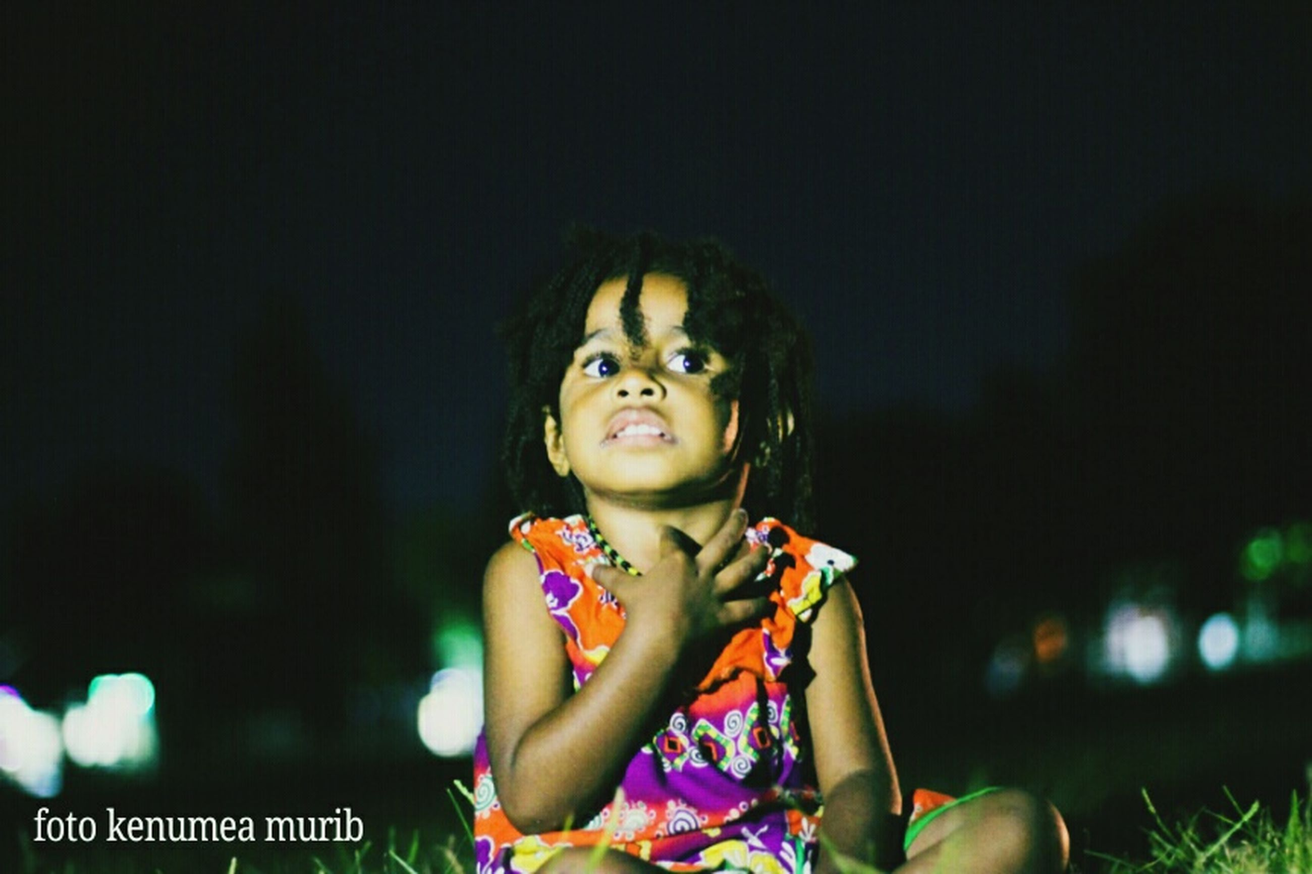 child, childhood, one person, front view, portrait, girls, looking at camera, night, women, females, offspring, innocence, holding, focus on foreground, waist up, real people, leisure activity, standing, dark, hairstyle
