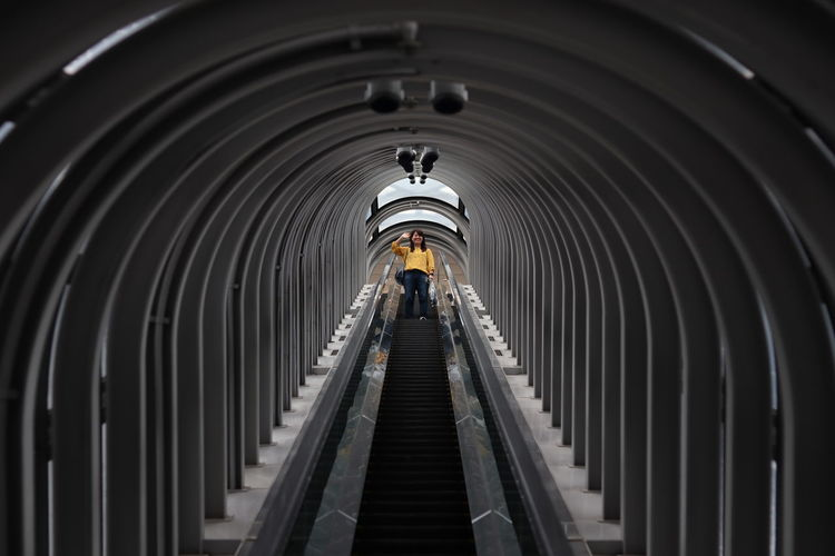 curve tunnel escalator Moments Of Happiness Illuminated Subway Train Subway Station Steps Steps And Staircases Symmetry Staircase Futuristic Architecture Tunnel Archway Light At The End Of The Tunnel Escalator Arch Concentric 2018 In One Photograph