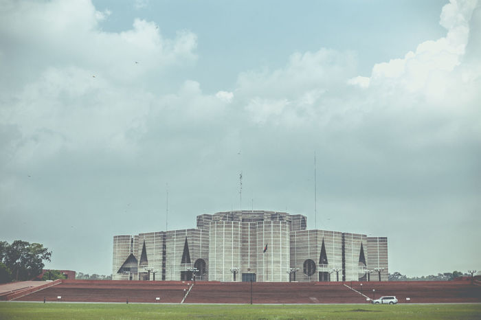 Shongshod bhaban - The Parliament House of Bangladesh. Architecture Bangladesh Building Building Exterior Capital Cities  Cloudy Dhaka Low Angle View National Monument Overcast Parliament Building Parliament Building Bangladesh Parliament House Parliament House Of Bangladesh Tall - High Travel Destinations Showcase July