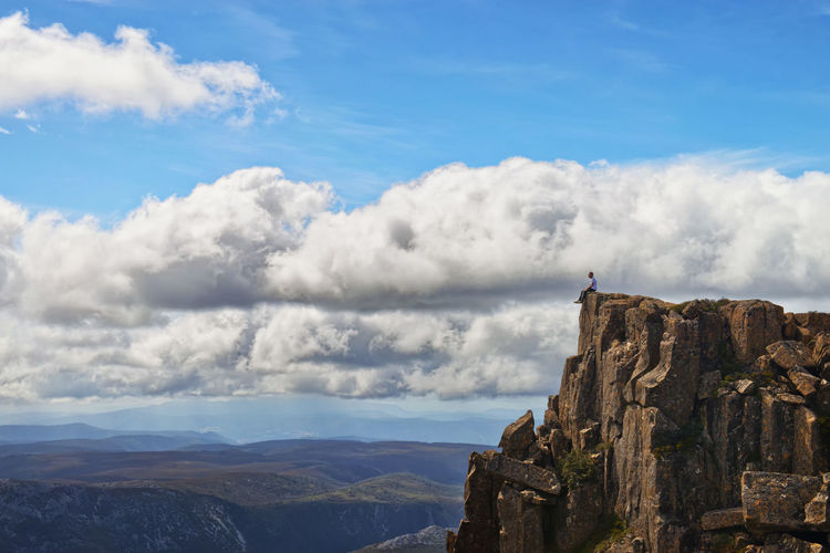 Atop Cradle Mountain in one of Tasmania's many stunning national parks. This was a very steep hike, with the last hour almost rock climbinig up the face of the cliffs to reach the summit here. But the breathtaking 360 degree views are truly spectacular and made the effort all worth it. Australia Edge Of The World Lost In The Landscape Nature Beauty In Nature Cliff Cloud - Sky Cradle Mountain Day Inspiration Mountain Mountain Range Nature One Person Outdoors Rock - Object Sky Tasmania Tranquility Travel Destinations Vertigo Be Brave