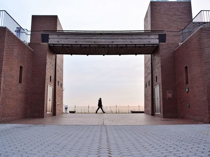 Full Length Of Silhouette Man Amidst Buildings At Battery Park