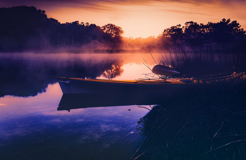 Dunns Swamp at sunrise, New South Wales, Australia EyeEmNewHere Australia Newsouthwales Kayak Kayaking Nature Water Lake Yellow Boat Mist Fog Sunrise Calm Peaceful Travelaustralia National Park Landscape Landscape_photography Light Boat Orangesky Reflectedclouds Shades Of Winter