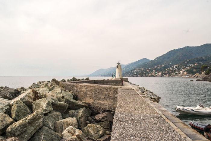 Harbour Lighthouse Architecture Beauty In Nature Boat Built Structure Day Horizon Over Water Liguria Marine Navigation Mountain Nature Outdoors Rock - Object Scenics Sea Sea Navigation Sky Tranquil Scene Tranquility Water