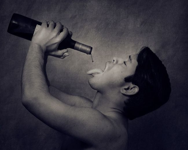 A man with a bottle of wine Fine Art Portrait Fine Art Photography Bottle Of Wine Wine Young Adult One Person Young Women Holding Shirtless Lifestyles Indoors  Close-up People
