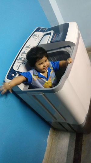 Little Boy Sitting In Washing Machine Playing Playing Alone Child Children Only Childhood One Person Boys People Girls