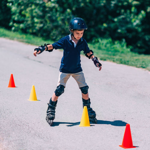 Boy on Roller Skating Class Rollerskating Roller Sport Outdoor Kid Fun Child Instructor Cones Active Ride Rollerblading Learning Teaching Roller Skating Senior Skate Young Happy Blade Rollerblade Road Boy Summer Skater Park Activity Helmet Blades Rollerblader Family Protector Pads Knee Pads Recreation  Protection Safe Sporty Enjoy Rollerblades Balance People Roller Skate Childhood One Person Sports Equipment Day Leisure Activity Square