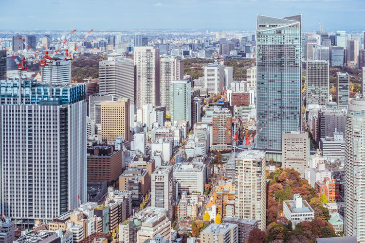 Asia Business concept for real estate and corporate construction - panoramic urban city skyline aerial view under bright blue sky and sun in Tokyo, Japan Tokyo,Japan City Cityscape Urban Skyline Blue Sky Backgrounds Landmark Tokyo Tower Multiple Lane Highway Road Junction Metropolitan Expressway Bright Light Corporate Business Construction Industry Panoramic ASIA Office Building Exterior Aerial View Skyscraper Modern Architecture Real Estate Agent Famous Place Morning Sun Sunrise - Dawn Sunset - Dusk