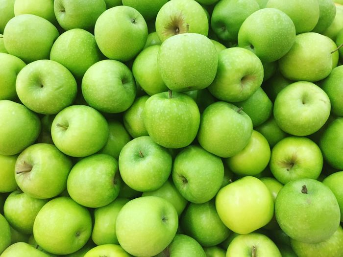 Green apple background Full Frame Healthy Eating Green Color Wellbeing Food And Drink Fruit Large Group Of Objects Organic High Angle View Market Apple - Fruit No People Abundance Retail  Close-up For Sale Food Still Life Freshness Backgrounds