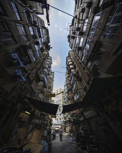 Fish-eye view of buildings against sky