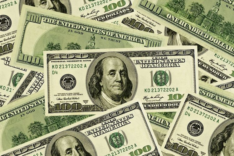 A stack of US dollars Earnings Money Cash Dollars Currency Finance Paper Currency Wealth Backgrounds Banking Paper Large Group Of Objects Human Body Part Making Money Gambling Corporate Business Close-up Business Full Frame Day Savings Indoors  People