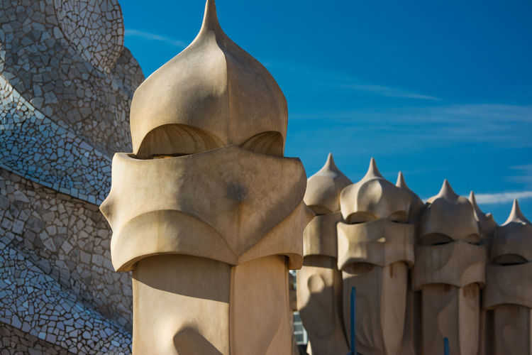 Roof-terrace of Casa Mila by Gaudi in Barcelona. No People Day Built Structure Architecture Blue Building Exterior Pattern Close-up Focus On Foreground Outdoors Sky Building Sunlight Rooftop Roof Barcelona Barcelona, Spain Barcelona España Casa Mila ( La Pedrera ) Gaudi Chimneys Knight