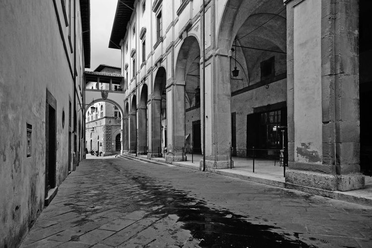 Perspective view of Logge Vasari ancient colonnade in Arezzo old center Colonnade Column Street Old Architecture Building Exterior Arch Window Outdoors Long Alley Cobblestone Medieval History Historic Historical Building Narrow Tuscany Arezzo Italy EyeEmNewHere EyeEm Best Edits