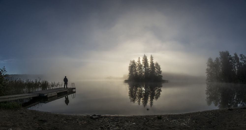 Beauty In Nature Calm Cloud - Sky Day Foggy Foggy Morning Lake Lakeshore Lakeside Majestic Nature Non-urban Scene Outdoors Reflection Remote Scenics Sky Solitude Standing Water Sunrise Tranquil Scene Tranquility Tree Water