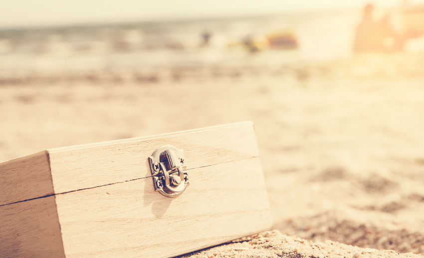 Close-Up Of Wooden Jewelry Box At Beach