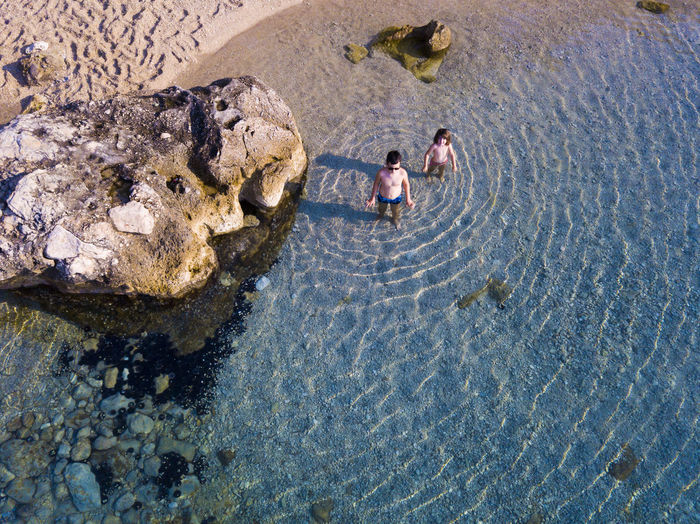 Aerial Angle View People On Beach