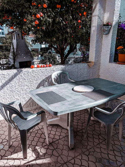 Orange tree garden Garden Orange Color Coral Colored Orange - Fruit Orange Tree Garden Mediterranean  SPAIN Homely Silver Colored White Washed Plastic Simplicity Marble Chair Table Sunshade Canopy Outdoor Cafe Sidewalk Cafe