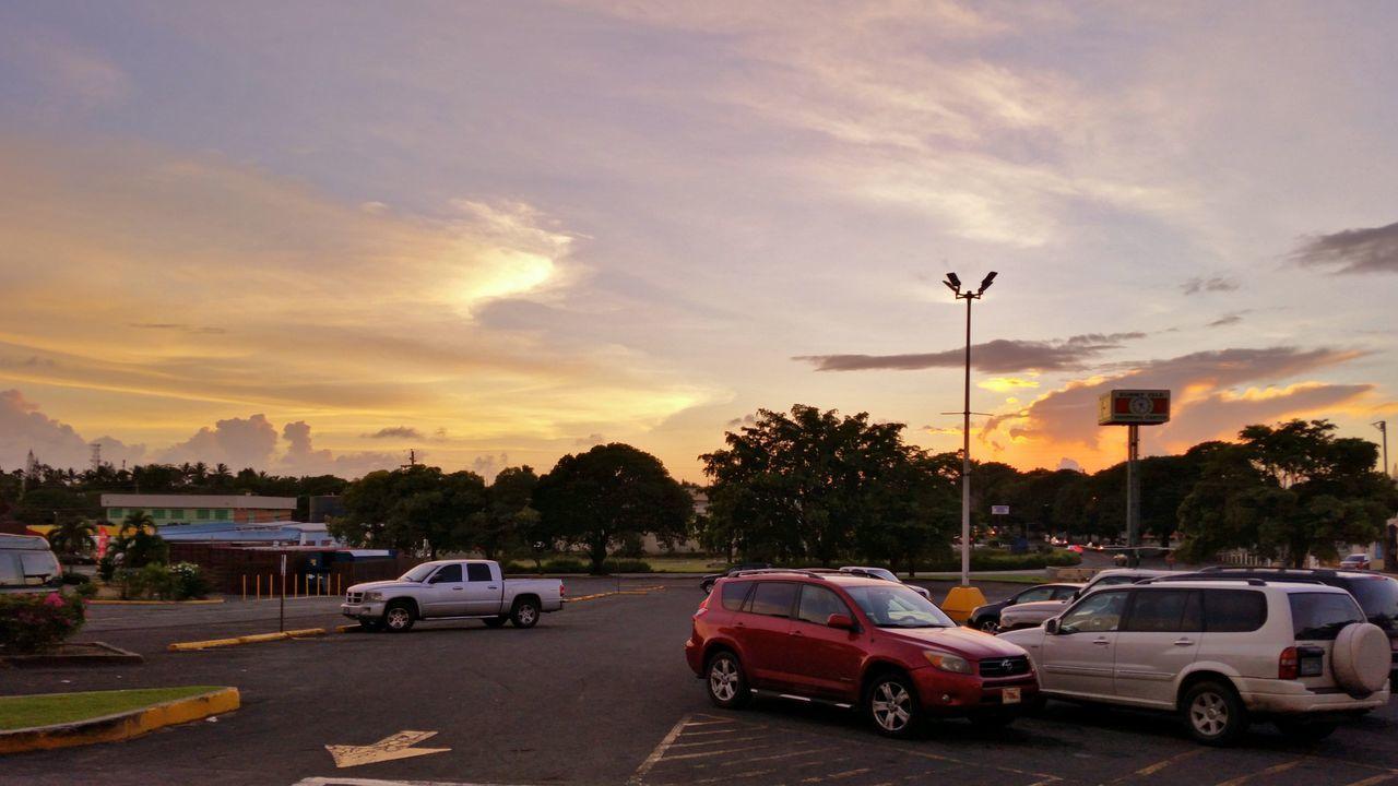 car, sunset, transportation, sky, land vehicle, cloud - sky, mode of transport, road, tree, outdoors, nature, no people, city