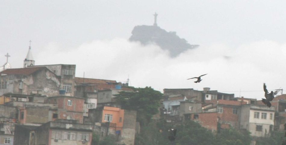 A bird flies in Rio de Janeiro, under the Christ Statue Rio De Janeiro The Christ Birds Carioca Cariocagram Devin Delano Favelas