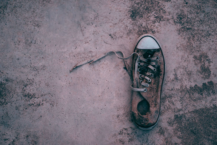 High angle view of abandoned shoes on floor