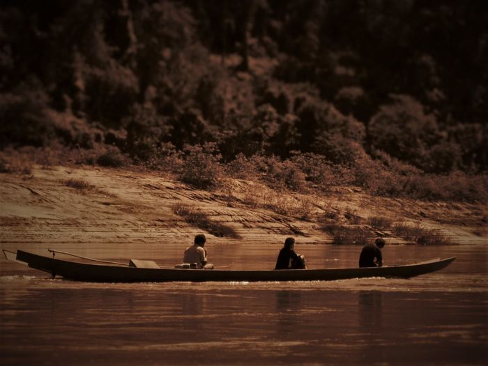 Boat Coastline Escapism Fishing Getting Away From It All Mekong Outdoors People River Seascape Shore Togetherness Traditional Transportation Tranquil Scene Transportation Traveling Working