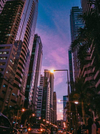 Emerald Avenue Ortigas Center Ortigas Center Colors Hues City Illuminated Cityscape Skyscraper Urban Skyline Modern Tree Sky Architecture Building Exterior Romantic Sky Romantic Sky EyeEmNewHere #urbanana: The Urban Playground