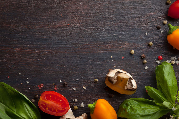 Directly above shot of vegetables and ingredients on wooden table
