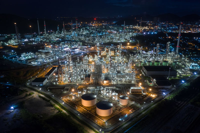 High angle view refinery of illuminated city at night