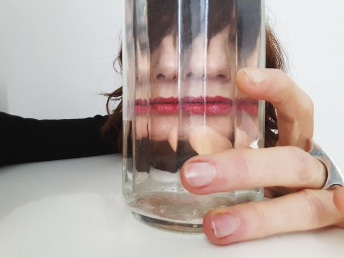 red lips Water Reflections Water Red Lips Red Color Portrait Of A Woman Personal Perspective Glass Art Glass Reflection Human Hand Water Dissolving Close-up Human Lips Transparent Finger Floating In Water Glass - Material Lipstick