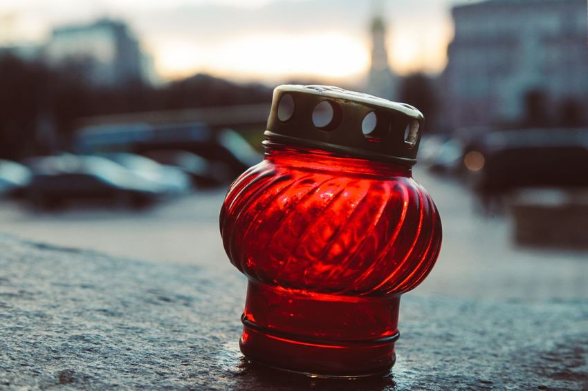 EyeEm Selects Focus On Foreground Bottle Red No People Close-up Table Jar Outdoors Lid Day Candle Holodomor Holocaust Memorial Kyiv Ukraine Genocide EyeEmNewHere