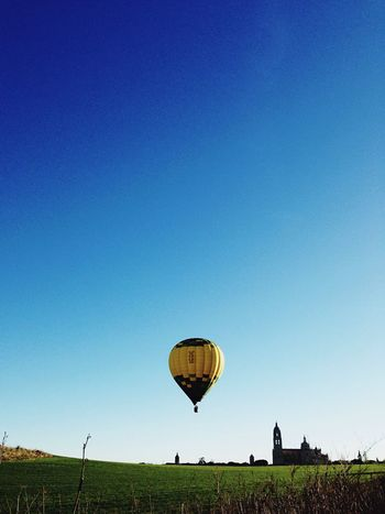 Globo Blue Hot Air Balloon Clear Sky Grass Tranquil Scene Outdoors Nature Landscape Sky No People Tree Day Beauty In Nature Parachute Long Goodbye The Great Outdoors - 2017 EyeEm Awards