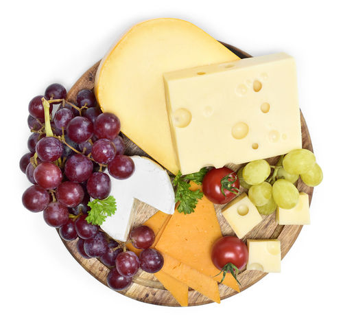Delicious cheese plate with various sorts of cheese like Emmentaler, gouda and cheese on a wooden cutting board, isolated on white background. Cheddar Isolated Brie Camenbert Cheese Cheese Plate Choice Close-up Dairy Product Food Food And Drink Freshness Fruit Gouda Grape Grapes Healthy Eating Isolated On White No People Still Life Studio Shot Tomato Variation Vegetable White Background