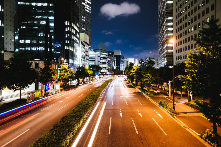 Light trails in Shinjuku, Tokyo. Architecture Building Building Exterior Built Structure City City Life City Street Cityscape Day Diminishing Perspective Growth Illuminated Long Exposure Modern Night No People Office Building Outdoors Residential Building Residential District Road Road Marking Sky The Way Forward Vanishing Point