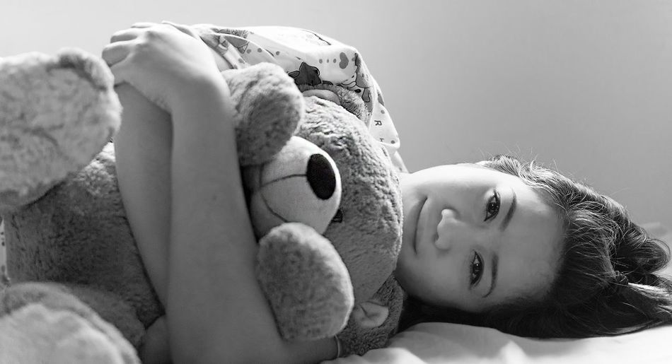 Black And White Embrace Looking At Camera Lying Down Lying On Side Portrait Smiling Stuffed Toy Teddy Bear Woman Young Adult Young Woman