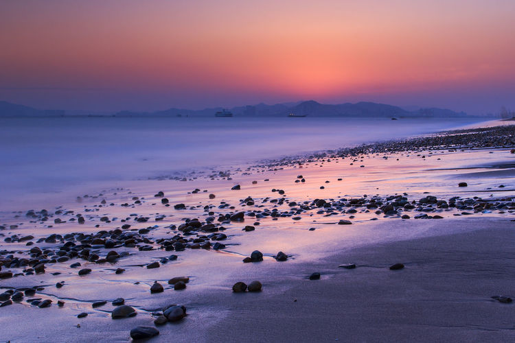 xiamen huandao road seascape sunset Beach Beauty In Nature Cold Temperature Day Horizon Over Water Landscape Large Group Of Animals Nature No People Outdoors Pink Color Scenics Sea Sky Sunset Tranquility Water Winter Xiamen, Huandao Road, Zengcuoan, Sunset, Dusk, Evening, Small Stones, Stones, Rocks, Pebbles, Cloudy, Travel, Attractions, Tide, Outdoor, Vacation, Water, Sea And Beach, Waves, Light, Sun, Sunset, Boat, Sunshine, Golden Yellow, Long Time Exposure, Fujian, First Eyeem Photo