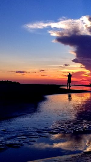 Ocean Sunrise Taking Photos Clouds Beautiful Colorful Distance One Person Hilton Head Island, SC Beach Silhouette Standing Reflection Sky Horizon Over Water Romantic Sky Dramatic Sky