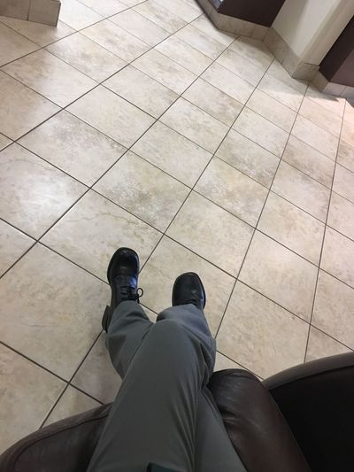 Low Section Human Leg Shoe Human Body Part Standing Real People Personal Perspective High Angle View Tiled Floor Human Foot One Person Lifestyles Men Day Indoors  Adult People