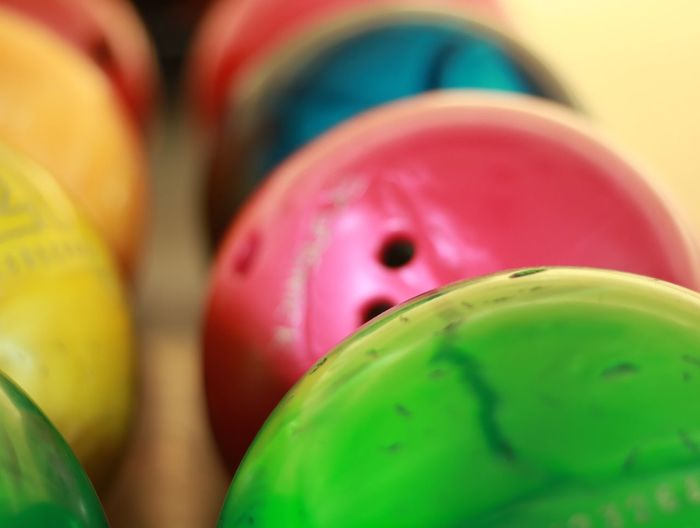 Bowling. EyeEmNewHere Bowl Blue Pink Color Green Color Bowling Balls Close-up Multi Colored Selective Focus Indoors  No People Green Color Pink Color Still Life Focus On Foreground In A Row Container Choice Backgrounds Art And Craft Group Of Objects Variation