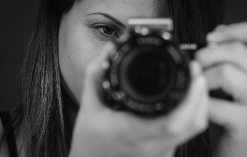 Close-up portrait of woman photographing