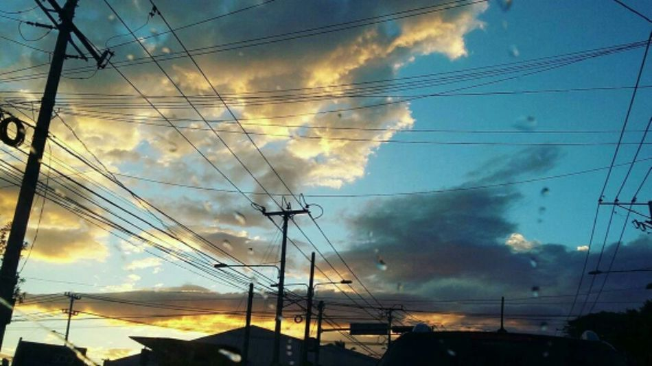 Skyporn. Cloud - Sky Electricity  Power Supply Fuel And Power Generation Technology Electricity Pylon Dramatic Sky Nature Scenics Outdoors Connection Beauty In Nature Sky Sunset Power Line  Cable No People Low Angle View Complexity Tree The City Light