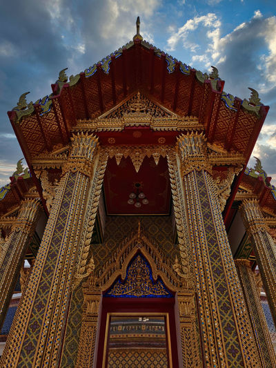 Beautiful golden and ornate entrance of the ratchabophit temple in bangkok, thailand.