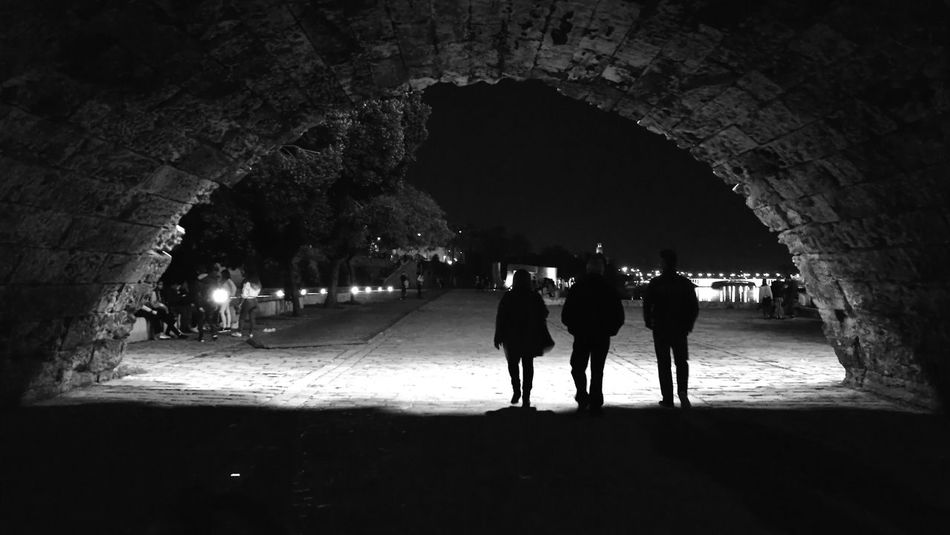 Lights at night [Seville in black and white] Next To The River Blackandwhite Under Bridge Light And Shadow Lights Shadow Sevilla Seville SPAIN EyeEmNewHere Tunnel Silhouette People