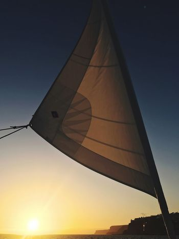 Flag Sunset Low Angle View Outdoors No People Patriotism Sky Day Travel Destinations Tranquility Clear Sky Tranquil Scene Blue Beauty In Nature Sunsets Boats Ships Sails Sails Up Silhouette Sailing Let's Go. Together.