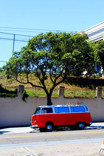 Campervan Car Clear Sky Contrast Day Land Vehicle Mode Of Transport Nature No People Orange Outdoors Road Sky Stationary Street Street Photography Transportation Tree